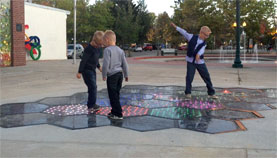 kids play on Solar Roadways in Sandpoint